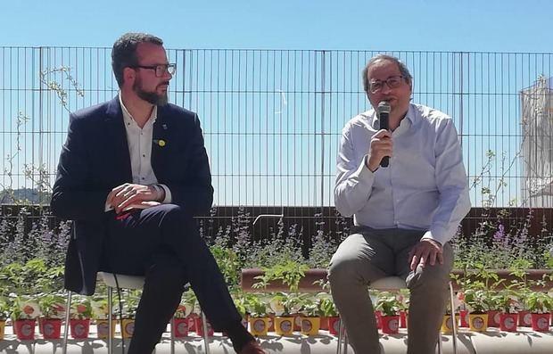 Jordi Bou -izquierda- junto a Quim Torra.